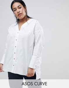 asos-curve-asos-design-curve-longline-long-sleeve-shirt-with-horn-button-detail-wYYFU1pPR2rZvy1sddG61-300