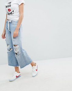 tommy-jeans-tommy-jeans-annie-mid-rise-culotte-with-raw-hem-and-ripped-knee-4ecnHSS1727aTDovnsYkt-300