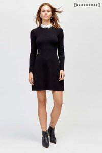 next-warehouse-black-embellished-collar-fit-and-flare-dress-2sMYUhHpb2bMzXMtmhQhZ-300